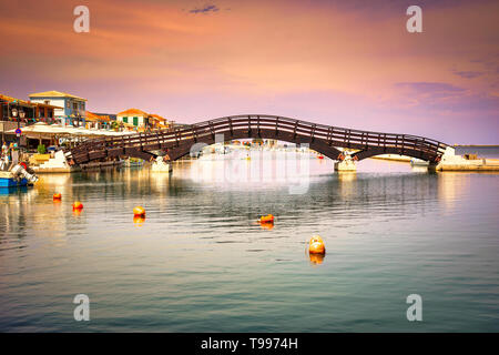Lefkas (Lefkada) town, amazing view at the small marina for the fishing boats with the nice wooden bridge and promenade, Ionian island, Greece - Stock Photo