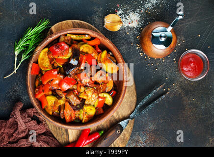 baked vegetables in bowl on a table - Stock Photo