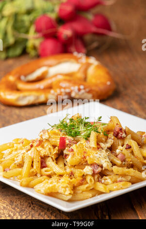 bavarian pasta with ham and eggs - Stock Photo