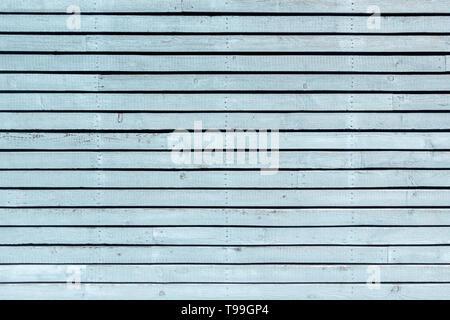 Pastel light blue painted, horizontal board wall - Stock Photo