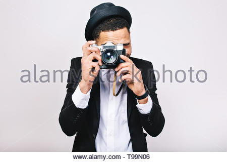Portrait excited handsome guy in suit making photo on camera on white background. Having fun, enjoying travel, tourist, isolated, smiling, happiness - Stock Photo