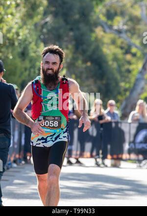 Blue Mountains, Australia - April 16 2019: Ultra-Trail Australia UTA11 race. Runner Morgan Huxley at the finish line. - Stock Photo