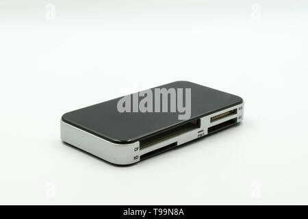 this is a capture of a black and silver multi port USB reader the picture is taken in a studio light and a white background - Stock Photo