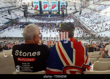 Rolling Stones Rock Music Fans, one Draped with the Union Jack Flag, wait the Start of a Concert by the Rolling Stones during the Legendary Group's No Filter Tour in the Velodrome Stadium Marseille (26 June 2018) - Stock Photo