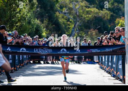 Blue Mountains, Australia - April 16 2019: Ultra-Trail Australia UTA11 race. Runner Paige Penrose at the finish line. - Stock Photo