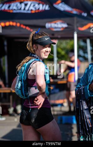 Blue Mountains, Australia - April 16 2019: Ultra-Trail Australia UTA11 race. Runner at the finish line. - Stock Photo