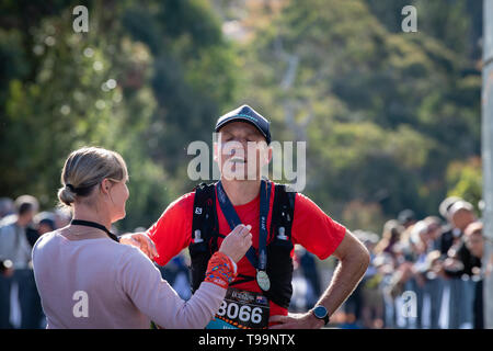 Blue Mountains, Australia - April 16 2019: Ultra-Trail Australia UTA11 race. Runner Mark Arbib exhausted at the finish line. - Stock Photo