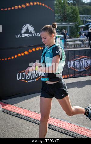 Blue Mountains, Australia - April 16 2019: Ultra-Trail Australia UTA11 race. Runner Sophie Butler at the finish line. - Stock Photo