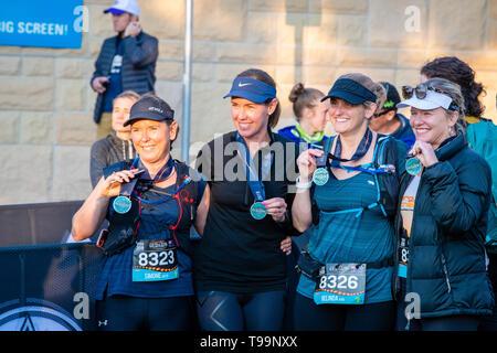 Blue Mountains, Australia - April 16 2019: Ultra-Trail Australia UTA11 race. Group of women celebrate their sucess at the race finish. - Stock Photo