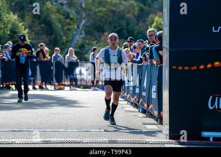 Blue Mountains, Australia - April 16 2019: Ultra-Trail Australia UTA11 race. Runner Tim Lovett at the finish line - Stock Photo