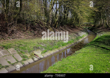 25.03.2019, Essen, North Rhine-Westphalia, Germany - The Berne is a small river that rises in the city of Essen and flows into the Emscher. The canali - Stock Photo