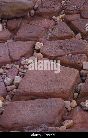 Conjugate Joints in Red Carboniferous Sandstone Exposed along the Fife Coast, Scotland, UK. - Stock Photo