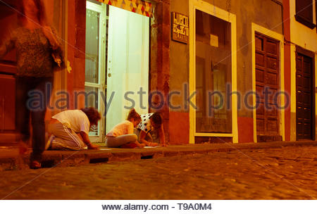 The old historic town of La Palma where the boats left for the exploration of america. In the evening with lanterns and kids playing on the side walk - Stock Photo