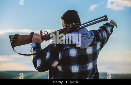 Noticed game. Man brutal unshaved gamekeeper nature background. Hunting permit. Hunting brutal masculine hobby. Hunting and trapping seasons. Bearded serious hunter spend leisure hunting. Look there. - Stock Photo