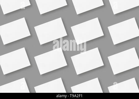 White blank horizontal business cards arranged in rows on gray solid color background, geometric business card mockup with copy space - Stock Photo