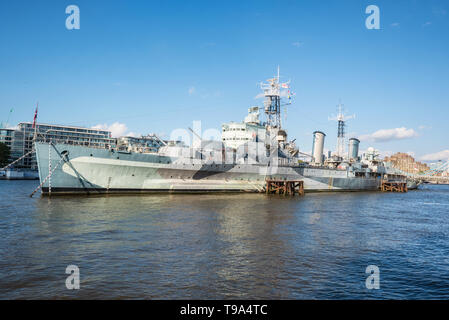 London, UK - May 12, 2019: HMS BELFAST a museum ship moored near tower bridge on the river Thames. A Town class light cruiser built for the Royal Navy in the 1930's which saw action in WWII. - Stock Photo