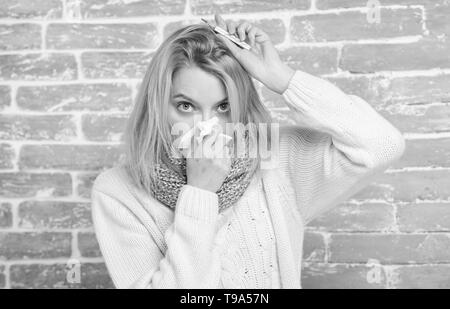 Measure temperature. Break fever remedies. High temperature concept. Woman feels badly ill. How to bring fever down. Fever symptoms and causes. Sick girl with fever. Girl hold thermometer and tissue. - Stock Photo