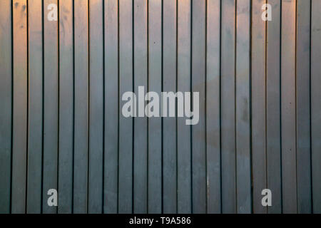 Industrial building wall made of metal sheet, flat background photo texture. - Stock Photo