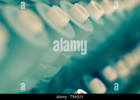 Background with a lot of blue  threads.  stacked in a rows,  Selective focus.blue tone palette. Background. - Stock Photo