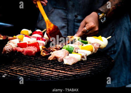 Summer or spring barbecue outdoors Close up Mouth Watering Gourmet Barbecue on Wooden Chopping Board at the Table. - Stock Photo