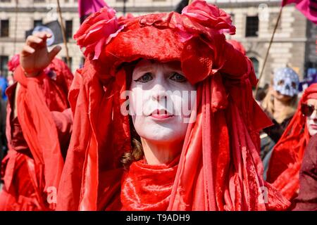 Blood of the Extinction Theatrical Group. Extinction Rebellion Climate Change Protest. Parliament Square, London. UK - Stock Photo