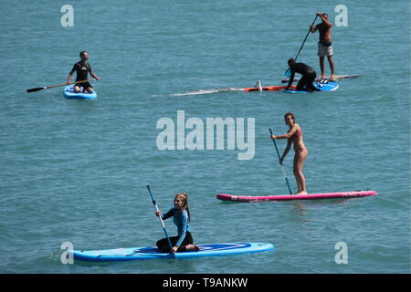 Sochi, Russia. 17th May, 2019. SOCHI, RUSSIA - MAY 17, 2019: Stand up paddle boarders in the Black Sea. Dmitry Feoktistov/TASS Credit: ITAR-TASS News Agency/Alamy Live News - Stock Photo