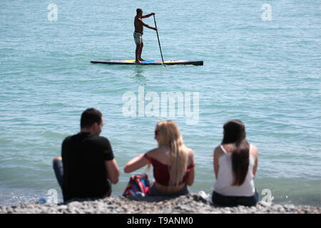Sochi, Russia. 17th May, 2019. SOCHI, RUSSIA - MAY 17, 2019: A stand up paddle boarder in the Black Sea. Dmitry Feoktistov/TASS Credit: ITAR-TASS News Agency/Alamy Live News - Stock Photo