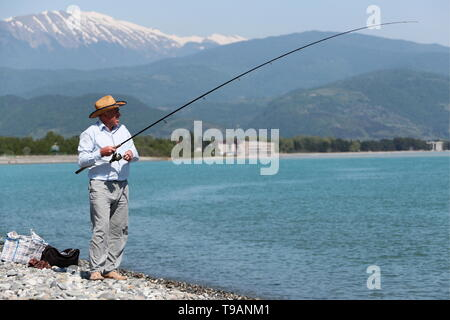 Sochi, Russia. 17th May, 2019. SOCHI, RUSSIA - MAY 17, 2019: A man fishing in the Black Sea in Adler District. Dmitry Feoktistov/TASS Credit: ITAR-TASS News Agency/Alamy Live News - Stock Photo