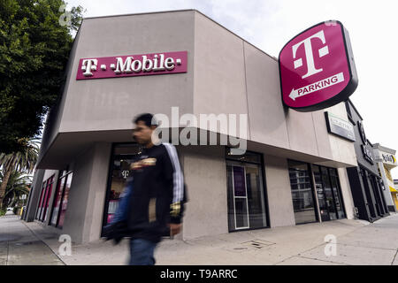 February 14, 2019 - Los Angeles, CA, United States - A pedestrian seen walking past a T-Mobile store in Los Angeles. (Credit Image: © Ronen Tivony/SOPA Images via ZUMA Wire) - Stock Photo