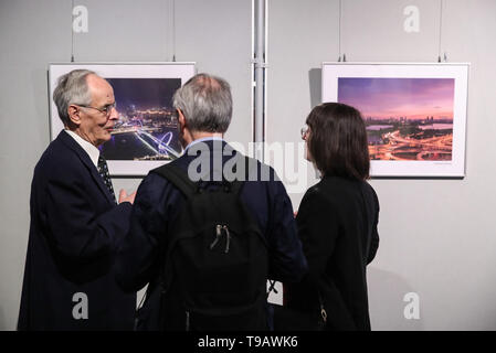 Berlin, Germany. 17th May, 2019. Visitors talk in front of pictures displayed during Nanjing Cultural and Tourism Weeks at the China Cultural Center in Berlin, capital of Germany, on May 17, 2019. Credit: Shan Yuqi/Xinhua/Alamy Live News