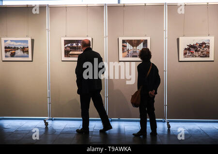 Berlin, Germany. 17th May, 2019. Visitors look at pictures displayed during Nanjing Cultural and Tourism Weeks at the China Cultural Center in Berlin, capital of Germany, on May 17, 2019. Credit: Shan Yuqi/Xinhua/Alamy Live News