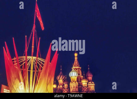 Moscow, Russia. 1st May, 1987. In Red Square, Moscow, the domes of famed St. Basils Cathedral are illuminated, as well as other decorative structures, in honor of May Day. Credit: Arnold Drapkin/ZUMA Wire/Alamy Live News - Stock Photo