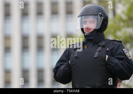 YEKATERINBURG, RUSSIA - MAY 17, 2019: A police officer during a rally against the construction of St Catherine's Cathedral on the site of a garden square in central Yekaterinburg. The cathedral is due for completion in 2023 to mark the city's upcoming 300th anniversary. On May 13, protesters pulled down initial temporary fencing around the site, now replaced with permanent one. After several days of protests, Russian President Putin offered to poll local residents; for the meantime, the construction of St Catherine's Cathedral has been halted. Donat Sorokin/TASS - Stock Photo