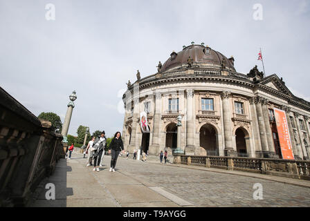 Beijing, Germany. 17th May, 2019. Pedestrians walk past the Bode Museum at Museum Island in Berlin, capital of Germany, on May 17, 2019. Museum Island, a UNESCO world heritage site, is the northern part of an island in the Spree river in Berlin. Its name comes from the complex of worldwide famous museums such as Altes Museum (Old Museum), Neues Museum (New Museum), Alte Nationalgalerie (Old National Gallery), Bode Museum and Pergamon Museum. May 18 marks the International Museum Day. Credit: Shan Yuqi/Xinhua/Alamy Live News - Stock Photo