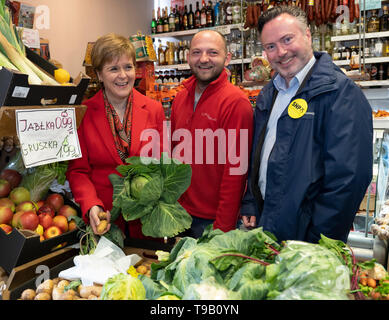 Edinburgh, Scotland, UK. 18 May 2019. Scotland's First Minister Nicola Sturgeon campaigns alongside lead SNP European candidate Alyn Smith on Leith Walk in Edinburgh. She visited a Polish grocery store spoke with the owner and examined the fresh vegetables. Credit: Iain Masterton/Alamy Live News - Stock Photo