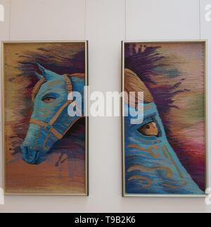 Beijing, China. 18th May, 2019. Photo taken with a mobile phone shows an art work by a disabled college student in the Art Gallery of China National Academy of Painting in Beijing, capital of China, May 18, 2019. Credit: Li Bin/Xinhua/Alamy Live News - Stock Photo