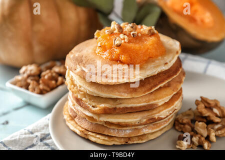 Stack of hot tasty pancakes with pumpkin on plate, closeup - Stock Photo