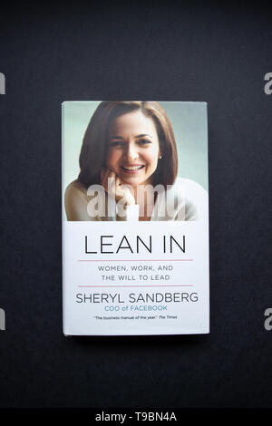 Paris, France - Feb 17, 2017: Directly above view of Lean in book by Sheryl Sandberg COO of Facebook isolated on gray background