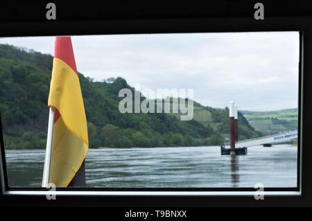 German flag in the boat on the Rhine river (Germany, Europe) - Stock Photo