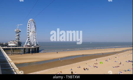 THE HAGUE, THE NETHERLANDS - APRIL 21, 2019: The beach of Scheveningen with the ferris wheel in the background - Stock Photo