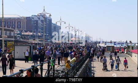 THE HAGUE, THE NETHERLANDS - APRIL 21, 2019: The beach promenade of Scheveningen, with a lot of people - Stock Photo