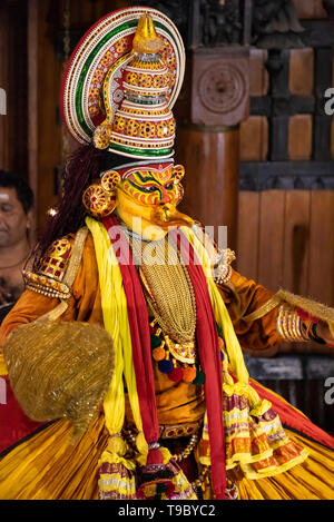 Vertical portait of a Kathakali performer in Kerala, India. - Stock Photo