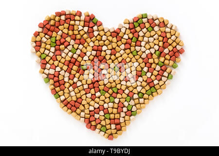 dry pet food in the shape of a heart shape isolated on white background
