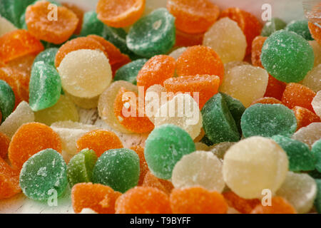 Different gelatin sweet fruit candy candies sugar. Assorted colorful jelly sweets. Colored confectionery for kids. Delicious multicolor candies in box - Stock Photo
