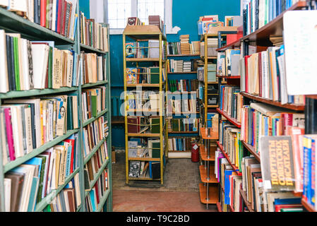 Library room Pass along the bookshelves. Blurred shelves with books. Selling books or getting knowledge at school or university - Stock Photo