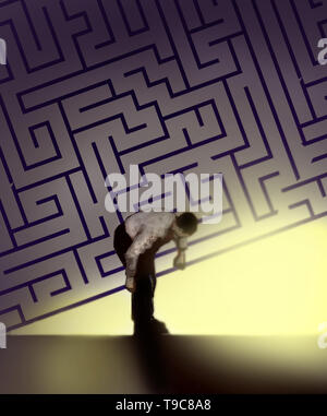 concept image of a man lifting up a maze to reveal bright light depicting a positive outcome - Stock Photo