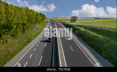 Beautiful view on agriculture field, blue sky and highway. Landscape photography. Nature scene - Stock Photo