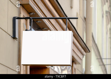 Mock up. Blank signboard on the wall of classical architecture building. - Stock Photo