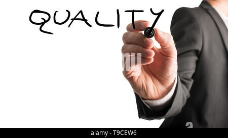Male hand writing Quality on virtual whiteboard. Isolated over white background. - Stock Photo