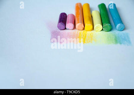 Close up view of the colorful chalk pastels on the white background, soft focus - Stock Photo
